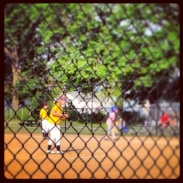 Sophie pitching in a game